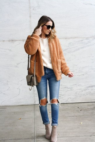 How to Wear Grey Suede Ankle Boots: Rock a tan fleece bomber jacket with blue ripped jeans for both chic and easy-to-achieve outfit. Infuse this outfit with a touch of refinement by wearing grey suede ankle boots.