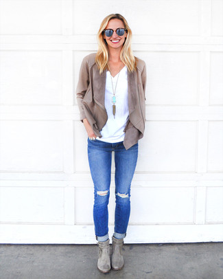 How to Wear Grey Suede Ankle Boots: For an edgy and casual ensemble, consider pairing a grey leather open jacket with blue ripped skinny jeans — these two pieces work pretty good together. Take an otherwise everyday ensemble down a more glamorous path by finishing with grey suede ankle boots.