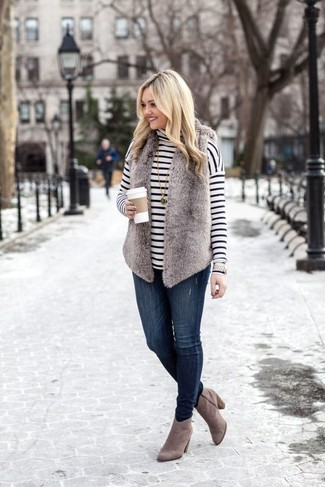 How to Wear Grey Suede Ankle Boots: A grey fur vest and navy skinny jeans are wonderful essentials that will integrate nicely within your current casual routine. A pair of grey suede ankle boots will take an otherwise utilitarian outfit down a more sophisticated path.