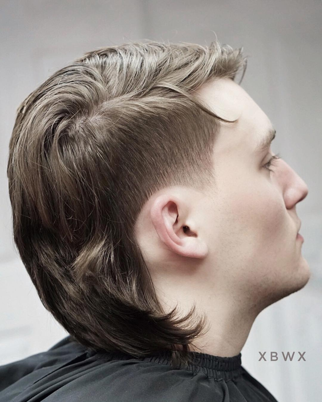 Modern side part mullet haircut